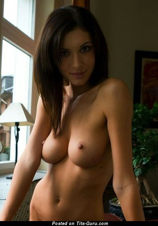 Image. Orsi Kocsis - sexy nude brunette with medium natural boob photo