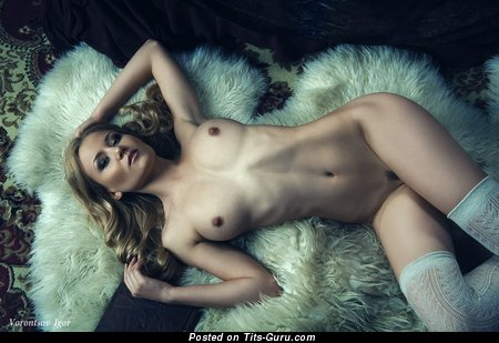 Image. Sexy naked blonde with medium natural boob pic