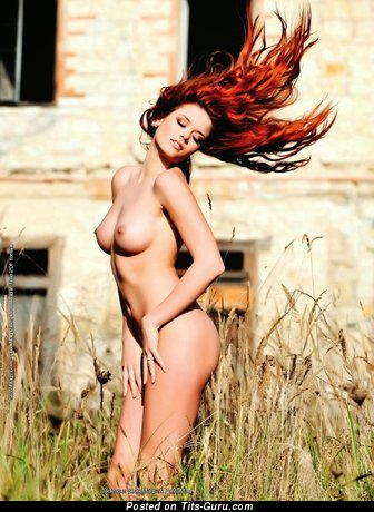 Image. Red hair with medium natural tits picture