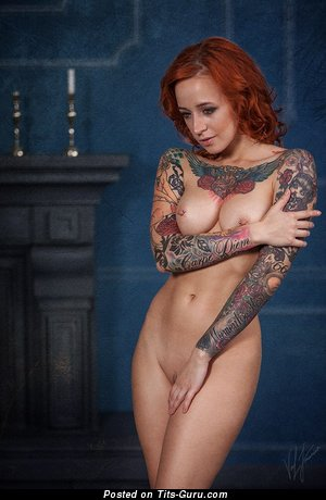 Jane Sinner: nude beautiful lady with medium natural boob, piercing & tattoo photo