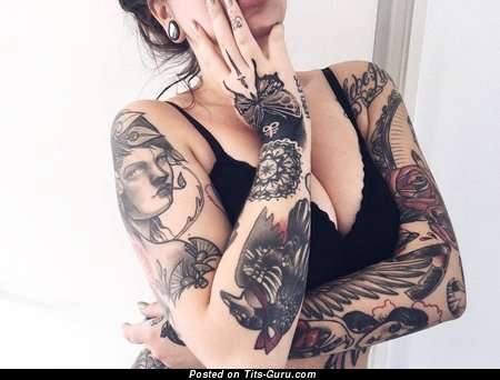 Nude blonde with tattoo picture