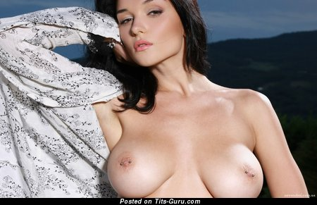 Image. Nude brunette with big natural boob and piercing photo
