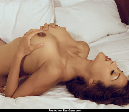 Good-Looking Topless Brunette Babe with Good-Looking Defenseless Silicone Tittes (18+ Photo)