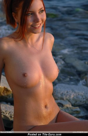 Image. Red hair with medium natural boobies pic