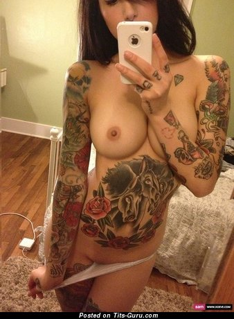 Image. Nude beautiful girl with medium tits and tattoo selfie