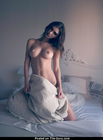 Sexy topless amateur wonderful girl with medium natural boobies photo