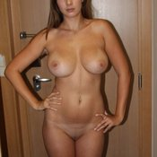 Sexy topless amateur awesome girl with big fake tits pic