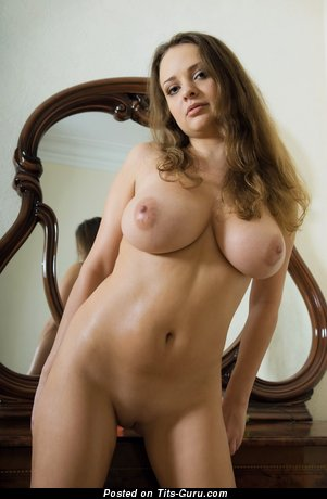 Image. Nude blonde with big natural tits and big nipples photo