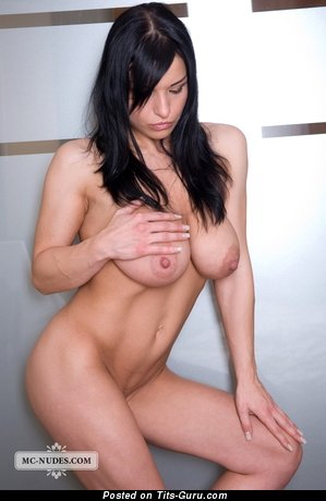 Aksana Shyker - nude brunette with medium natural tittes and big nipples image