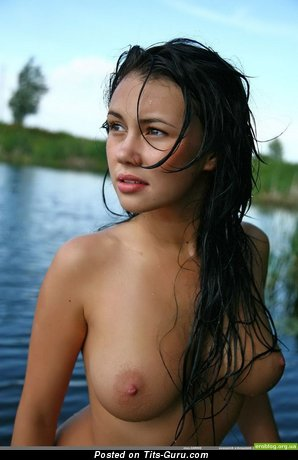 Image. Wet nude brunette with medium natural breast image