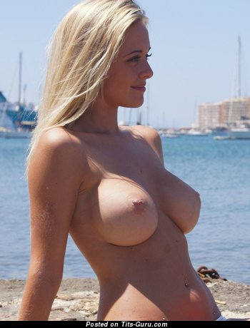 Sexy nude blonde with medium tittes and piercing picture
