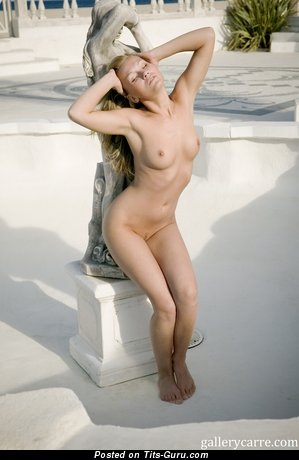 Image. Naked blonde with medium natural tittes picture