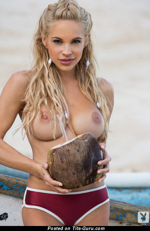 Sexy topless blonde with medium natural tittys and big nipples photo