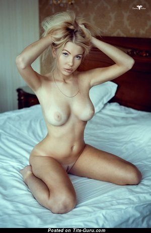 Image. Blonde with medium natural boobs pic