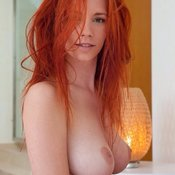 Redhead - hot lady with big natural boob image