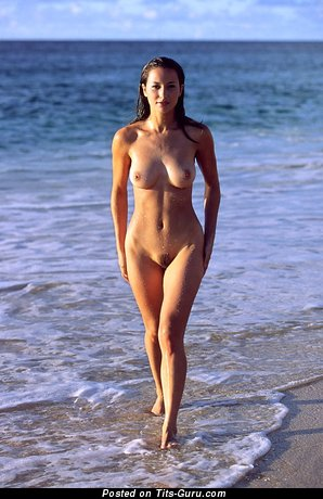 Handsome Wet Brunette Babe with Handsome Naked Natural C Size Chest, Huge Nipples, Sexy Legs on the Beach (Sexual Picture)