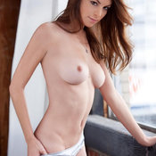 Amber Sym - red hair with medium natural tittes pic