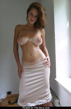 Boobs fall out of bikini