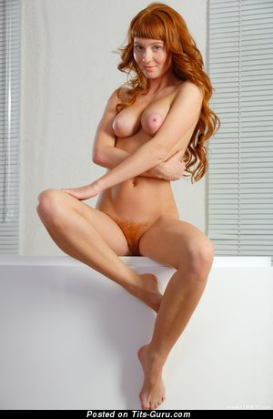 Image. Ossana - naked red hair with medium natural boob photo