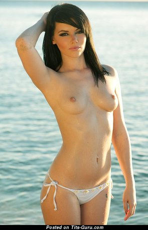 Image. Rosie Jones - naked brunette with small natural breast photo