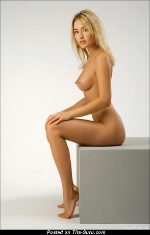 Image. Nude blonde with medium tots picture