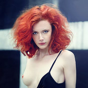 Red hair with medium natural tittys pic