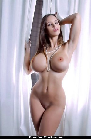 Sexy naked brunette with big fake boobs and big nipples picture