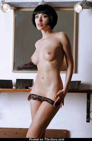 Image. Naked brunette with medium tittes pic