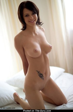 Image. Brunette with medium natural tittes and tattoo image