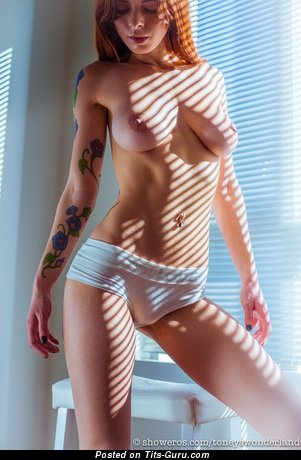 Naked wonderful female with medium natural boobies pic