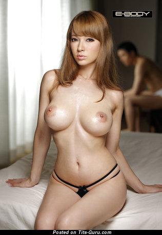 Image. Tia Bejean - sexy topless asian with medium tots photo