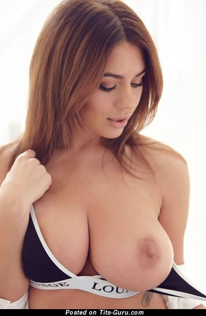 Topless brunette with natural boob and big nipples image