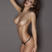Topless brunette with big natural breast pic