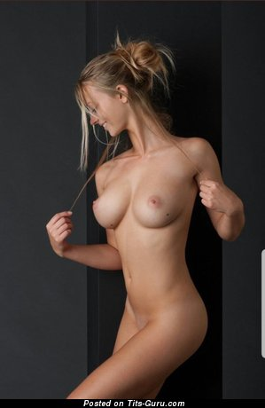 Sexy nude blonde with medium natural tittes photo