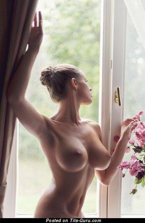 Image. Naked beautiful female with big fake tots image