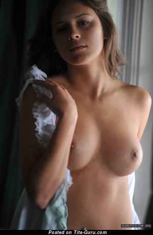 Image. Nina James - nude beautiful lady with medium tits photo