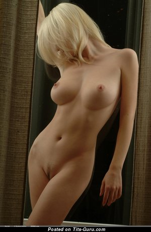 Image. Naked blonde with medium tittys image