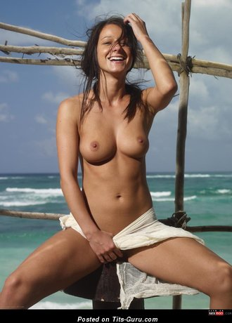 Image. Topless brunette with medium natural tits image