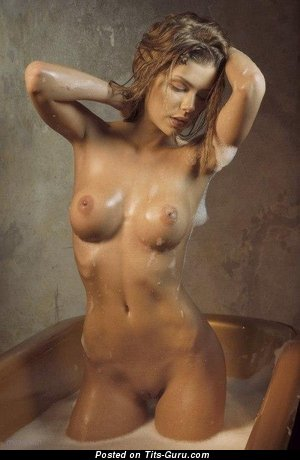 Image. Wet naked hot girl with medium tots photo