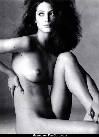 Image. Naked brunette with medium natural boobs image