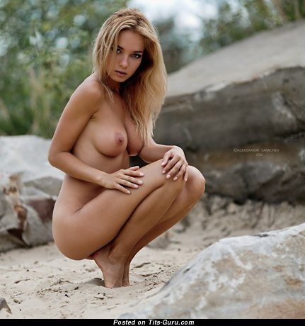 Image. Naked blonde with medium natural tots picture