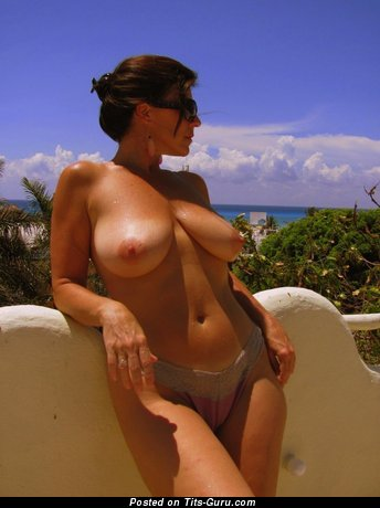 Topless amateur brunette with natural boobies photo