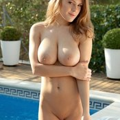 Sexy topless blonde with medium natural tits image