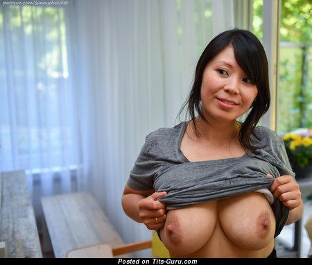 Sunny Chocolat: naked asian brunette with medium natural tits photo