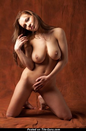 Daisy - nude brunette with medium natural tittes image