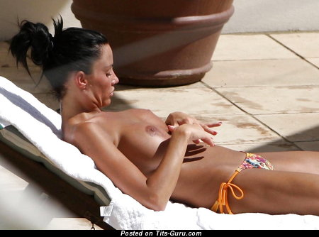 Topless amateur brunette with medium natural boob picture