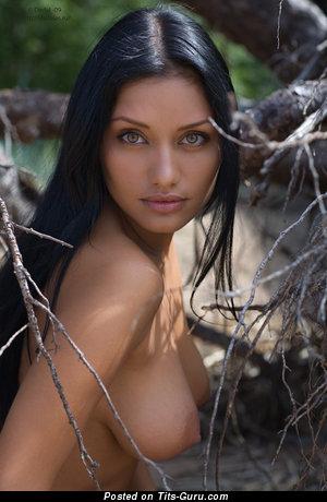 Image. Naked brunette with medium natural breast image