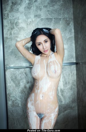 Image. Sexy wet naked asian with big natural boob image