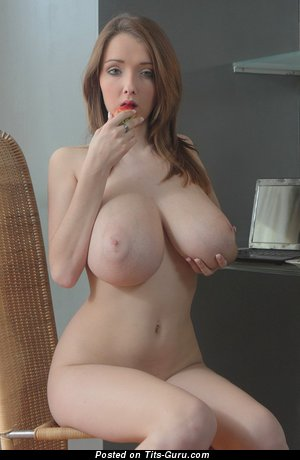 Sexy topless beautiful female with big natural tittes photo