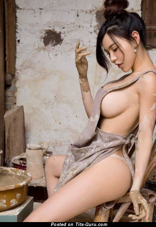 Naked asian brunette with medium breast photo